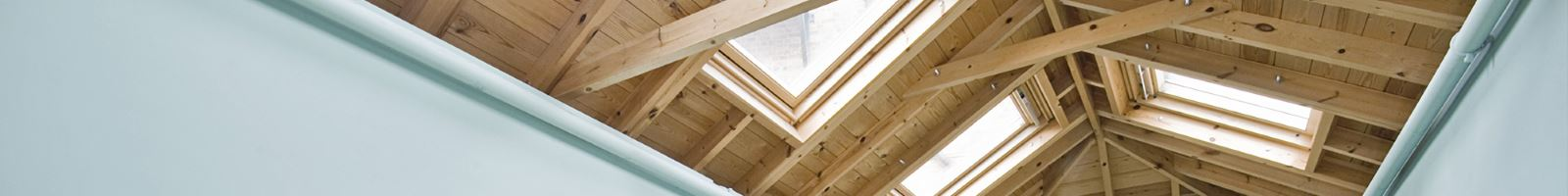 loft conversion wooden roof with velux windows