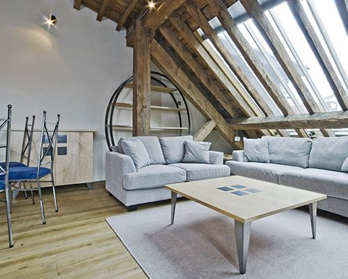 loft conversion wooden banners with modern grey furniture